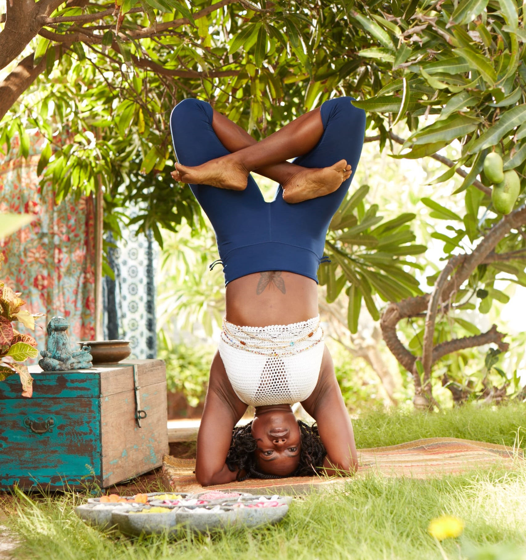 IAYT Certified Yoga Therapist Janet Haughton Quarshie Doing Headstand Wearing A Mika Wear Outfit
