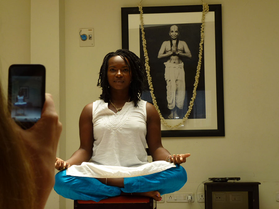 Janet sitting in Padmasana at KYM in front of Krishnamacharya