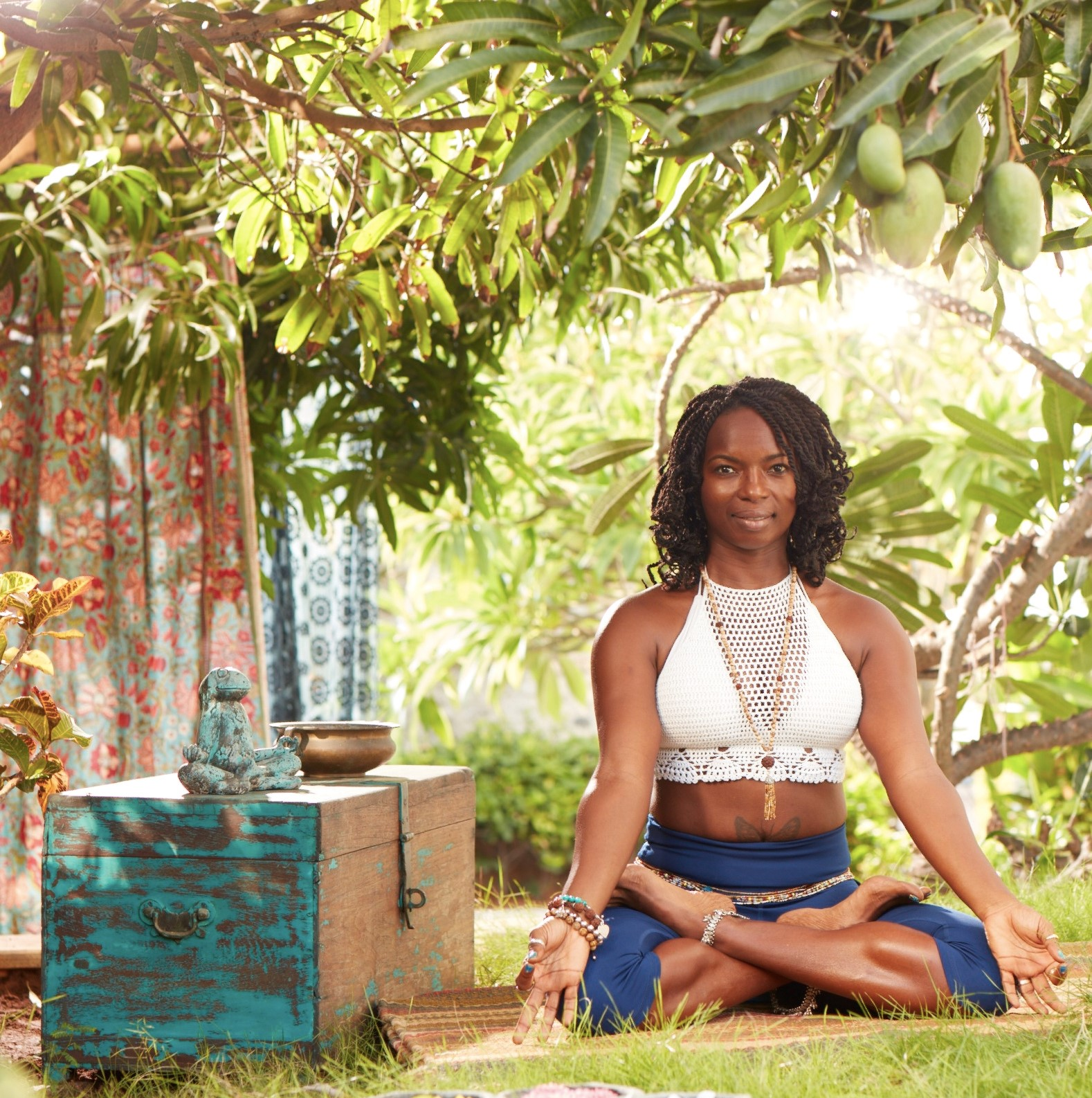 Janet Haughton Quarshie Sitting In Padmasana Wearing A Blue Mika Wear Outfit