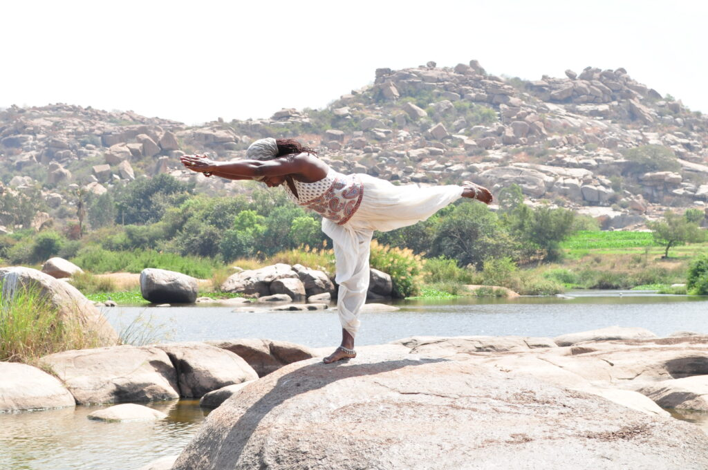 Informative Blogs On Yoga Meditation And Mindfulness Janet Haughton Quarshie In A Warrior Pose In Hampi
