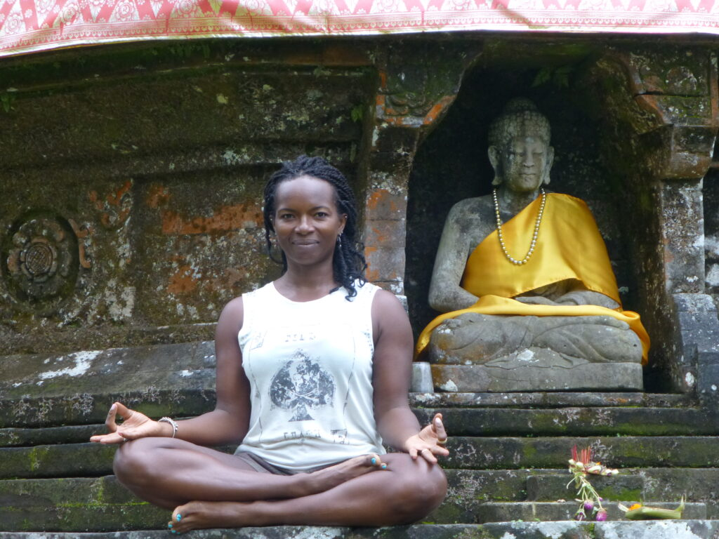 Informative Blogs On Yoga Meditation And Mindfulness Janet Haughton Quarshie Sitting In Front Of Temple In Thailand