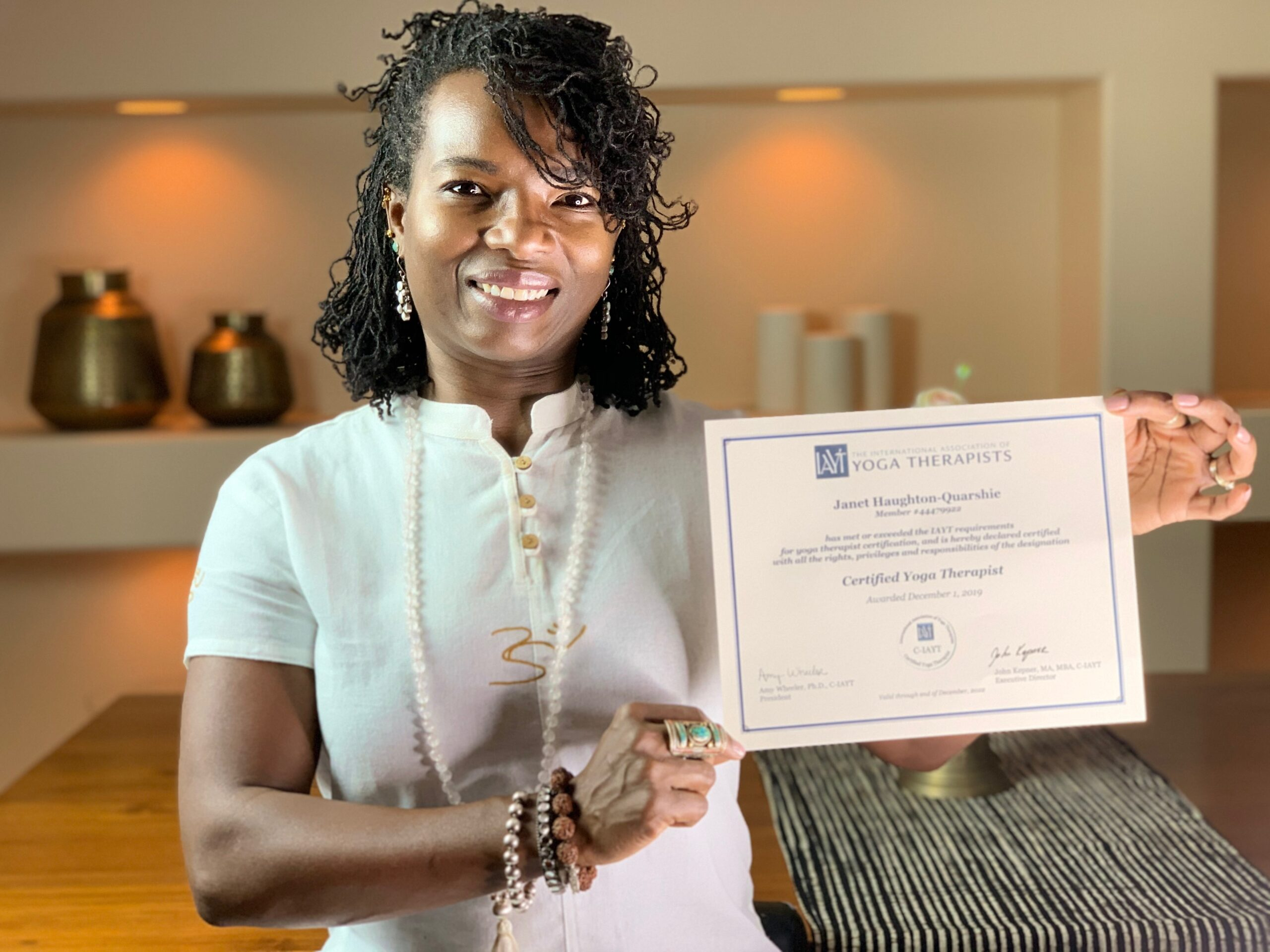 Janet Haughton Quarshie Proudly Holding Her IAYT Certificate